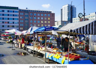 Tampere, Finland - 3 September 2018: The popular Tammelantori / Tampere Market Square filled with cafes, produce sellers and a flea market.