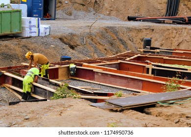 Tampere, Finland - August 21, 2018: Builders are building a groundwork of block of flats. Wearing safety gears, Personal protective equipment (PPE)