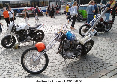 Tampere, Finland - August 31, 2019: Old customized Harley Davidson chopper with long and high double exhaust pipes  which rise up. at the bike show Mansen Mäntä Messut (Tampere piston fair in English)