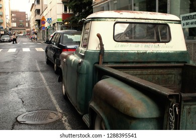 TAMPERE, FINLAND - AUGUST 5, 2017: rear view of a american classic truck  pickup GMC 100 with old winchester rifle is parked on the street