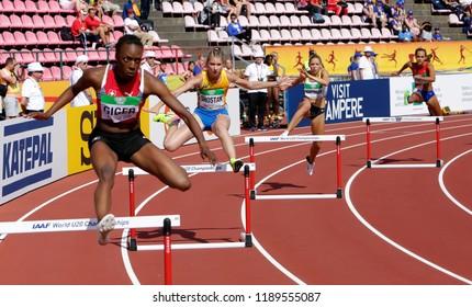 TAMPERE, FINLAND, July 11: YASMIN GIGER (SUI), MARYANA SHOSTAK (UKR), LISA SOPHIE HARTMANN (GER), SOLVEIG VRALE (NOR) 400 metrs hurdles heats on the IAAF World U20 Championship in Tampere, Finland 11