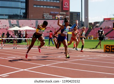 TAMPERE, FINLAND, July 15: BRITANY ANDERSON, Tia JONES, Cortney JONES at finish line in 100 metres hurdles final in the IAAF World U20 Championship in Tampere, Finland 15th July, 2018.