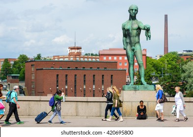 TAMPERE, FINLAND - JULY 18, 2015: Tammerkoski bridge statue.