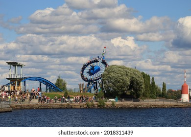 Tampere, Finland - July 31 2021: The view  on the big, rotating Waka raft  in Sarkanniemi amusing park viewed from opposite side of  water channel