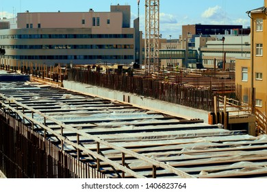 Tampere, Finland - May 6 2019: Tampere Deck and Arena project construction site. Workers are wearing safety gears, Personal protective equipment (PPE). Tampere police station in the background.