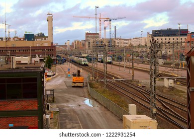 Tampere, Finland - November 5 2018: Trains at Tampere station. Cranes in the background.
