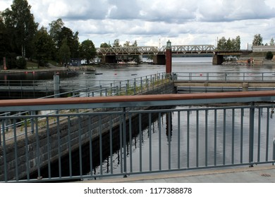 Tampere, Finland - September 7 2018: A railroad bridge in the background. Gateways in Tampere in action. View of the floodgates in Tampere on a cloudy day,