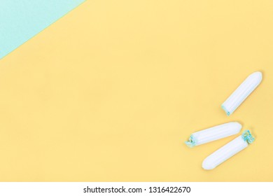 Tampons on creative colour background, female intimate hygiene period products, top view