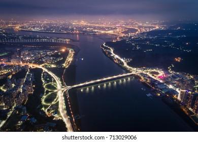 Tamsui/Bali Night View Aerial Photography - Tamsui River with Guandu Bridge birds eye view use the drone photography at night, shot in Tamsui District, New Taipei, Taiwan.