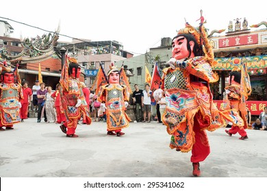 TAMSUI,TAIWAN- June 21:People dressed up statues of holy general on June 21,2015 in Tamsui,Taipei,Taiwan. The fair held annually for honor of the Ching-Shui Master.