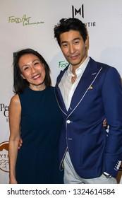 Tan Kheng Jua and Chris Pang arrive at The Rafi 2019 Pre-Oscars Gifting Lounge at the Waldorf Astoria Hotel, Beverly Hills, CA on Feb. 22, 2019.