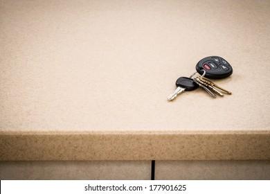 Tan kitchen counter with automotive car keys