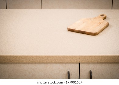Tan kitchen counter with cutting board minimalist style