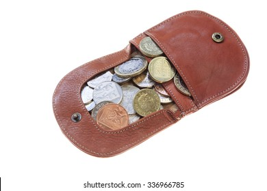 Tan leather coin purse with Sterling coins isolated on a white background. UK, Britain, Europe.