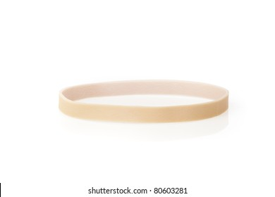 A tan rubber band against a white background