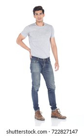 Tan Skin Asian black hair, handsome muscle good looking man in grey t shirt jean pant brown shoes, stand pose in studio lighting white background, male model
