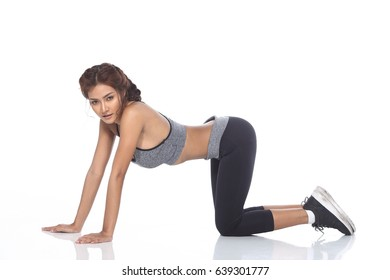 Tan Skin Asian Fitness Girl in Sexy Cute Sport Bra black spandex pants Exercise warm up in white studio room, practice pose extension kneeing allure