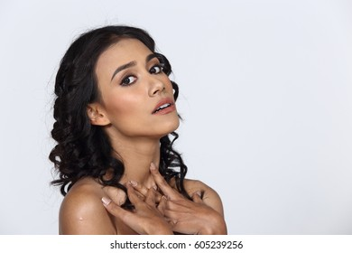 Tan Skin Curl Hair Asian Woman open shoulder express feeling on face and eyes, question, curious, what, half body studio lighting gray background, copy space