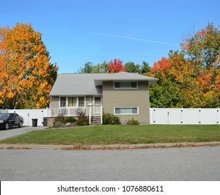 Tan Suburban Back Split Two Level Home Autumn Season Blue Sky USA