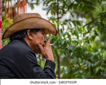 Tana Toraja, Bellwether of funeral taking rest and having a ciggarette, Sulawesi, Indonesia, 21/08/2019