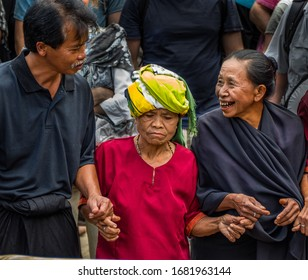 Tana Toraja, funeral ceremony, local people dressed in traditional clothes, SULAWESI, INDONESIA, 17/08/2019