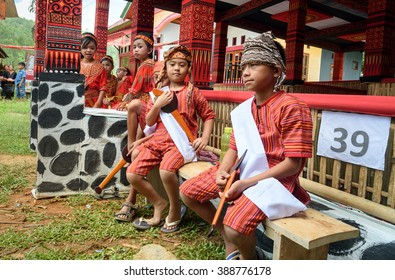 Tana Toraja, Indonesia - Dec 10, 2015:  Unidentified group of young girls and boys in traditional clothes at funeral ceremony. In Toraja the funeral ritual is the most elaborate and expensive even