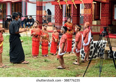 Tana Toraja, Indonesia - Dec 10, 2015:  Unidentified group of people in traditional clothes at funeral ceremony. In Toraja the funeral ritual is the most elaborate and expensive even