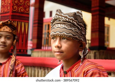 Tana Toraja, Indonesia - Dec 10, 2015:  Unidentified young boy in traditional clothes at funeral ceremony. In Toraja the funeral ritual is the most elaborate and expensive even