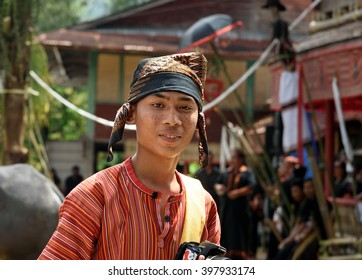 Tana Toraja, Indonesia - Dec 10, 2015:  Unidentified boy in traditional clothes at funeral ceremony. In Toraja the funeral ritual is the most elaborate and expensive even