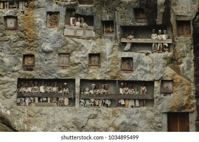 Tana Toraja, Indonesia - nov 2009 : rock tombs carved into the rock face and simulacra tau tau exposed on the balconies in Lemo in the Tana Toraja region in Sulawesi
