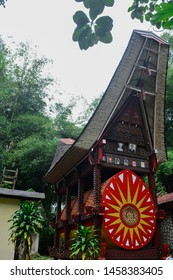 Tana Toraja, South Sulawesi - 04 June 2019; traditional house tongkonan tribe toraja with a roof that resembles a buffalo horn and display photos of ancestors on display for homage