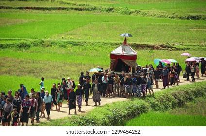Tana Toraja, Sulawesi, Indonesia - December 2011. Procession at the funeral in Tana Toraja. Group of people walking to the funeral place in Sulawesi, Indonesia.