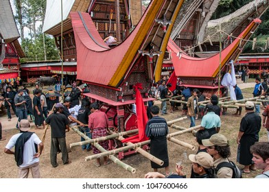 Tana Toraja, Sulawesi, Indonesia - oct 2009 : at the beginning of the procession the coffin of the deceased is positioned on the canopy shaped like a Toraja house