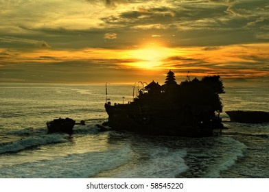 Tanah Lot and beauful sea waves in golden sunset, Bali