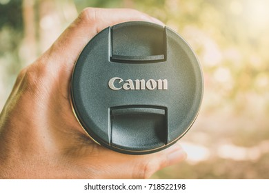 Tanah Bumbu Regency, Indonesia - 01 September 2017 : Asian Man handling Canon Wide Lens, Canon Inc. is a Japanese corporation specialized in the manufacture of imaging and optical product.