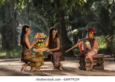 Tanah Embet village, West Lombok, Indonesia - April 23, 2017 : Chit chat during preparations for the Hindu rituals in the morning