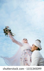 Tanah Merah, Kelantan, Malaysia -18.6.2018 - The bride and groom are doing romantic pose at the beach during their wedding photo session , selective focus