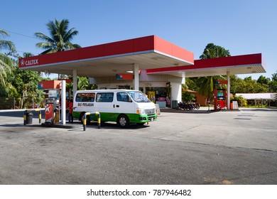 """Tanah Merah, Kelantan / Malaysia - March 19 2013: The surroundings of Kota Bahru, a petrol station """"CALTEX"""", car refueling."""