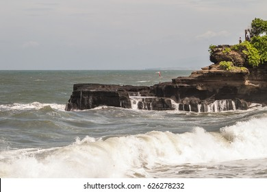 Tanah Lot is one of Bali's most beautiful temples surrounded by the ocean and dedicated to the guardian spirits of the sea
