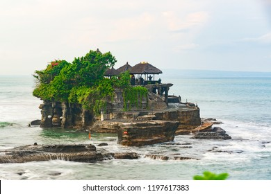 Tanah Lot Temple is Bali's important landmarks, offshore setting and sunset backdrops. An ancient Hindu shrine perched on top of an outcrop amidst constantly crashing.