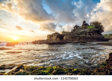 Tanah Lot water temple in Bali during sunset. Famous hindu temple main Bali landmark. Indonesia.