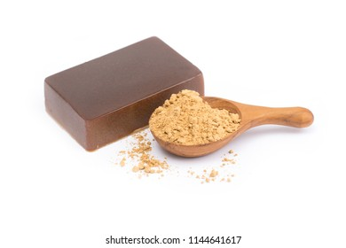 Tanaka Powder Face powder of the Burmese in wooden spoon and Tanaka soap isolated on white background