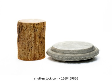 Tanaka wood and stone slabs on a white background Thanaka is a cosmetic for face makeup.