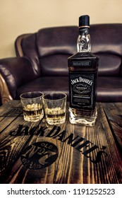 Tanakajd / Hungary 02.21.2018 : Jack Daniel's Frank Sinatra edition whiskey bottle and two glasses on wooden pallet table in man's cave leather couch background