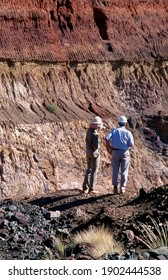 Tanami Desert, Northern Territory, Australia, February 21, 1996: View of two mine workers standing on the edge above an open cut gold mine pit in the Northern Territory, Australia