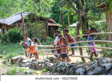 TANAY, PHILIPPINES - MAY 7: A group of curious local children gather by a roadside on May 7, 2016 in Tanay, Rizal, Philippines.