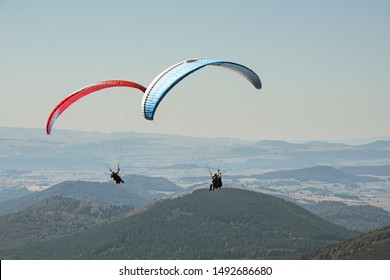Tandem paragliders thermalling in Puy de Dome, Auvergne, French Massif Central. France