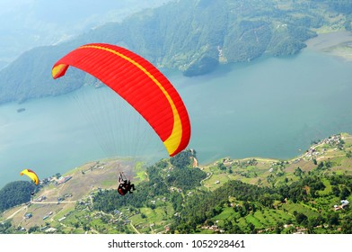 Tandem paragliding. Red paraglider. Top view