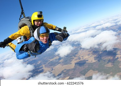 Tandem skydiving. Above the clouds.