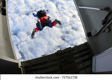 Tandem skydiving. Exit.